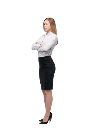 business skeptical: Full length beautiful woman in formal clothes. Isolated. Stock Photo