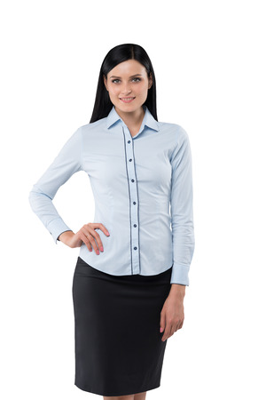saleslady: Brunette girl in the formal shirt holds a hand on the waist. Stock Photo