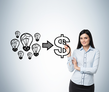 Brunette smiling woman performs a concept of the successful business. Light bulbs as ideas are equal to dollar sign as a concept of the profit.