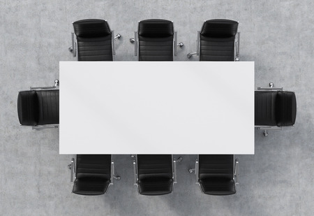 modular home: Top view of a conference room. A white rectangular table and eight black leather chairs around.