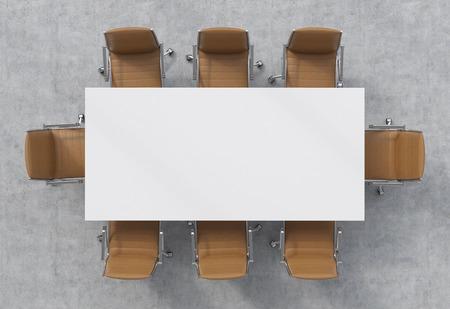 会議室の平面図です。白い長方形のテーブルと 8 つの茶色の革椅子の周り。 写真素材
