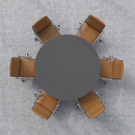 round chairs: Top view of a conference room. A dark grey round table and six brown leather chairs around.