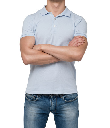 denim jeans: Front view of a person in a blue polo t-shirt with crossed hands. isolated. Stock Photo