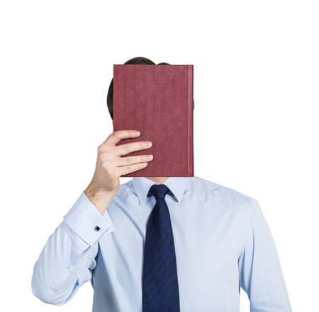unobtrusive: A person holds a red book in front of the head. Isolated. Stock Photo