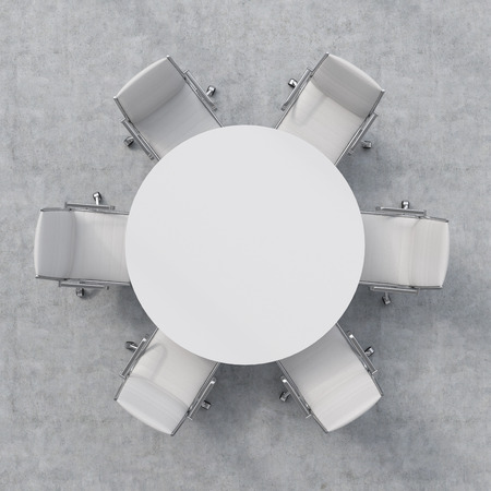 dining room table: Top view of a conference room. A white round table and six chairs around.