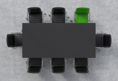Top View of a 3d rendering conference room. A black rectangular table and eight chairs around, one of them is green. Office interior. Stock Photo