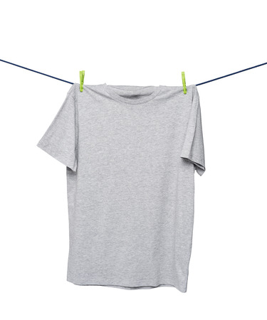 collarless: Close up of a grey t-shirts on the rope. Isolated.
