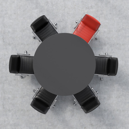 round chairs: Top view of a 3d rendering conference room. A black round table and six chairs around, one of them is red. Office interior.