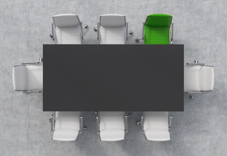 green office: Top View of a 3d rendering conference room. A black rectangular table and eight chairs around, one of them is green. Office interior. Stock Photo