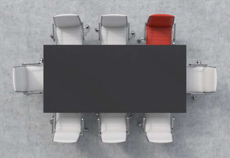 Top View of a 3d rendering conference room. A black rectangular table and eight chairs around, one of them is red. Office interior. Stock Photo