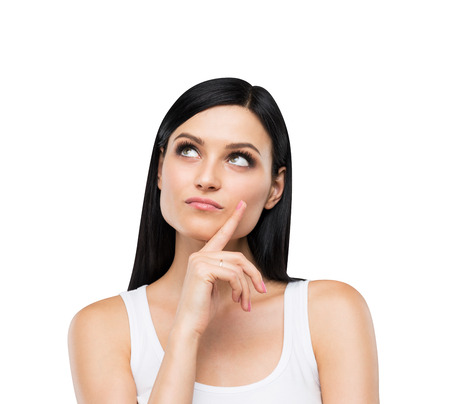 A portrait of a pensive brunette lady in a white tank top. Isolated. Stock Photo