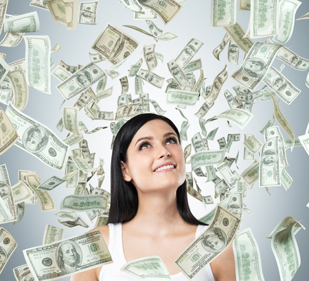 windfall: A Portrait of a dreamy brunette lady in a white tank top. Dollar notes are falling from the ceiling.