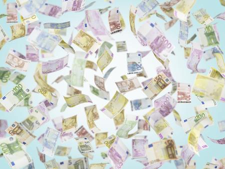 billets euro: Flying EURO notes over blue background.