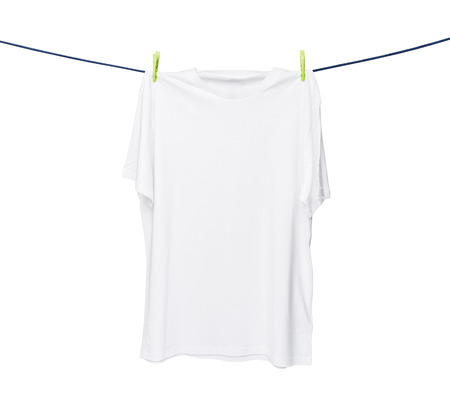 collarless: Close up of a white t-shirt on the rope. Isolated on white background. Stock Photo