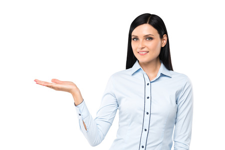 saleslady: A Portrait of a brunette lady with the open palm. Isolated. Stock Photo