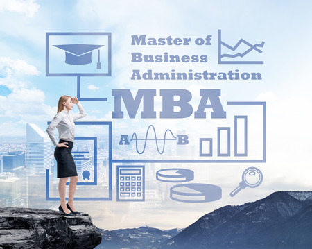 masters of rock: Businessman standing on a rock and looking at the future perspectives of MBA degree. Mountain landscape.