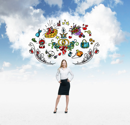 sopping: Young woman is dreaming about sopping. Colourful shopping icons are flying in the air. Cloudy cloud on background.