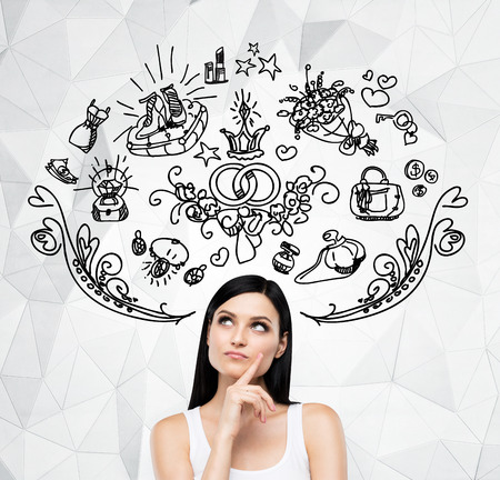 sopping: Brunette woman is dreaming about sopping. Shopping icons are flying in the air. Contemporary background.
