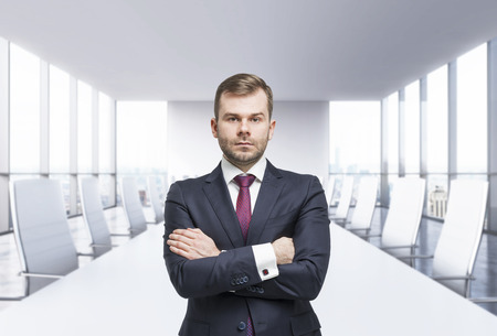 unemotional: Confident businessman with crossed hands. Panoramic meeting room. New York view,