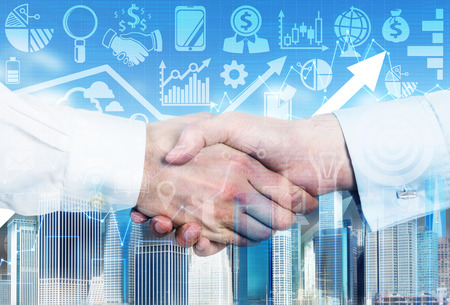 shirtsleeves: A handshake is over the growing arrow and business icons in blur on the background.
