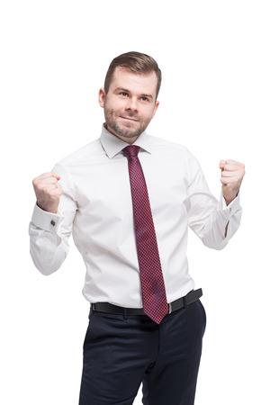 Nahaufnahmeportrait der glücklichen erfolgreicher Student, Geschäftsmann zu gewinnen, die Fäuste gepumpt Erfolg feiern. Isoliert. Standard-Bild