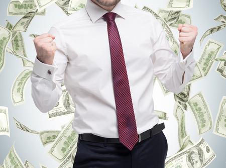 幸せ成功する学生、ビジネス目標に達した男のポートレート、クローズ アップ。拳が励起されました。成功を祝うことの概念。ドルのノートは、孤立した背景に落ちています。 写真素材 - 43048857