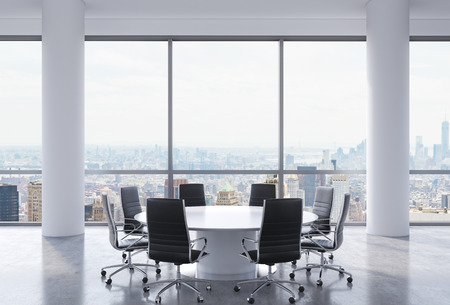 round chairs: Panoramic conference room in modern office, New York city view. Black chairs and a white round table. 3D rendering. Stock Photo