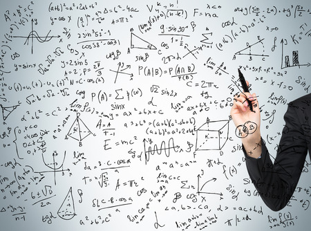 Womans hand is pointing out the complicated math calculations. Math formulas are written on the glass screen. Stock Photo