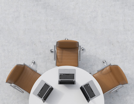 round chairs: Top view of a half of the conference room. A white round table, three brown leather chairs. Three laptops are on the table. Office interior. 3D rendering. Stock Photo