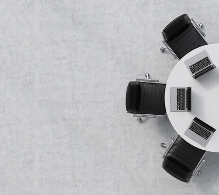 Top view of a half of the conference room. A white round table, three black leather chairs. Three laptops are on the table. Office interior. 3D rendering. Archivio Fotografico
