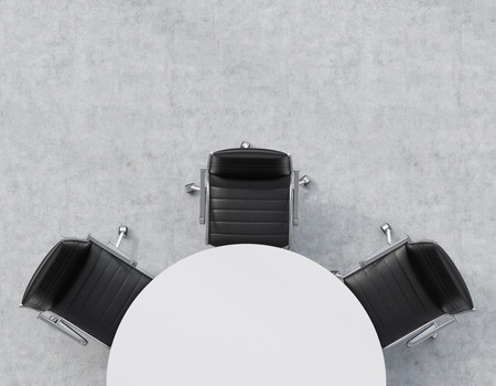 round chairs: Top view of a half of the conference room. A white round table, three black leather chairs. Office interior. 3D rendering.