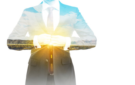 supernatural power: A transparent silhouette of a businessman. A road landscape on the background.