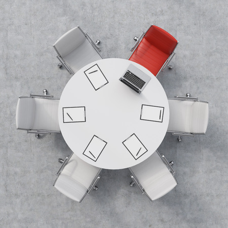 round chairs: Top view of a conference room. A white round table, six chairs, one of them is red. A laptop and five papers. Office interior. 3D rendering. Stock Photo