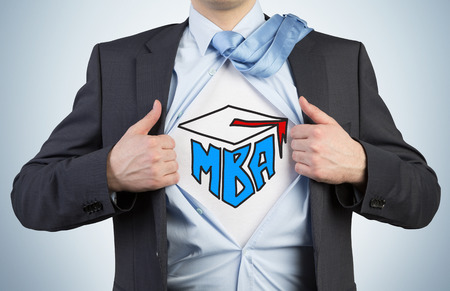 Successful young student is tearing the shirt. Business education icons are drawn on the chest. A concept of the MBA degree. Stock Photo