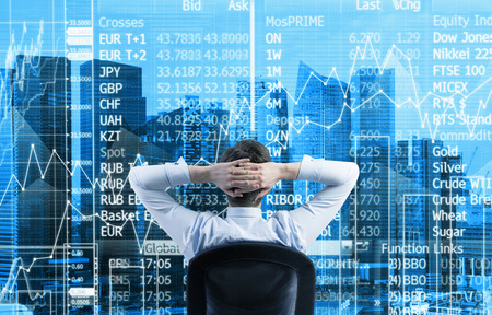 financial market: Rear view of the relaxing businessman is in a modern panoramic office in Singapore. Stock market data on the glass screen.