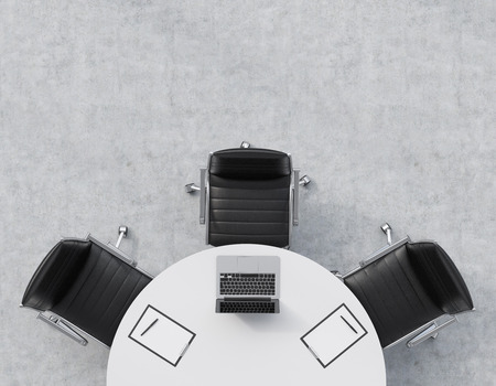 round table conference: Top view of a half of the conference room. A white round table, three black leather chairs. A laptop with legal pads are on the table. Office interior. 3D rendering.