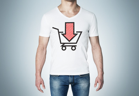 purchasing power: Close-up of a man in a white t-shirt with a sketch of the red down arrow and the basket. A concept of the decreasing of the purchasing power.