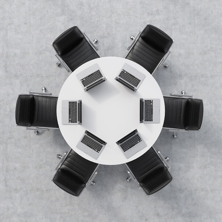 round chairs: Top view of a conference room. A white round table, six chairs. Six laptops are on the table. Office interior. 3D rendering.