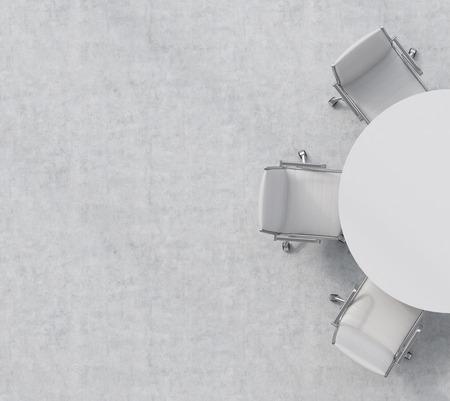 Bovenaanzicht van de helft van de vergaderzaal. Een witte ronde tafel, drie witte lederen stoelen. Kantoor interieur. 3D-rendering.