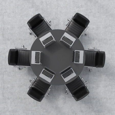 round chairs: Top view of a conference room. A black round table, six leather chairs and six laptops. Office interior. 3D rendering.