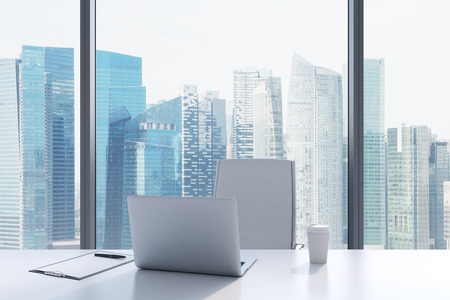 company job: A workplace in a modern panoramic office with Singapore view. A white table, white leather chair. Laptop, writing pad and a cap of coffee are on the table. Office interior. 3D rendering.