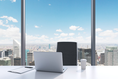 writing pad: A workplace in a modern panoramic office with New York City view. A white table, black leather chair. Laptop, writing pad for notes and a cap of coffee are on the table. Office interior. 3D rendering. Stock Photo