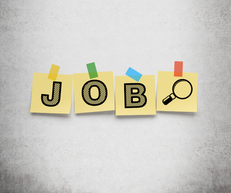 vacancies: Yellow stickers are on the concrete wall with the word JOB as a symbol of the searching of the vacancies in the Internet.