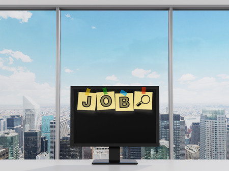 seeker: Yellow stickers are on the display with the word JOB as a symbol of the searching of the vacancies in the Internet. New York Panoramic view, modern office.