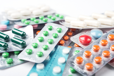 antihistamine: Pile of colorful medicine pills and capsules in blister packs