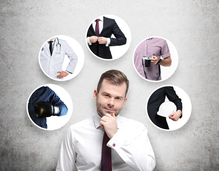 formal shirt: A handsome person in a formal shirt is thinking about different professions. Concrete background.