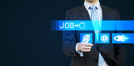 job hunting: A person in a suit is pushing the hologram button which is symbolised the search. A concept of the Job hunting. Dark background.