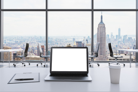 legal office: A workplace in a modern panoramic office in Manhattan, New York. A laptop with white screen, notepad and a coffee cup are on the white table. Black Leather chairs. Open space. 3D rendering. Stock Photo