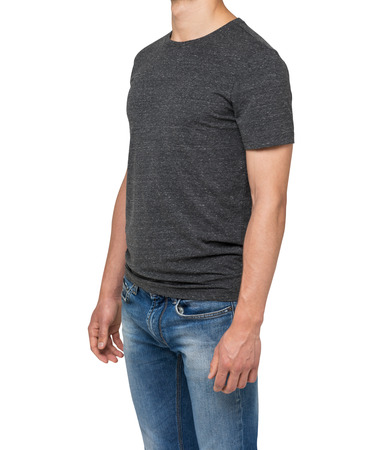 near side: Side view of a man in a dark grey t-shirt and denims. Isolated on white.