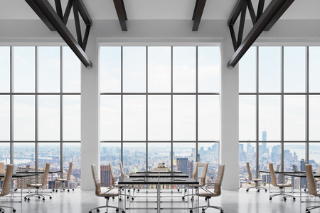 Modern workplaces in a modern bright clean interior of a loft style office. Huge windows with New York panoramic view. Black desks equipped with laptops, brown leather chairs. 3D rendering. Stock Photo